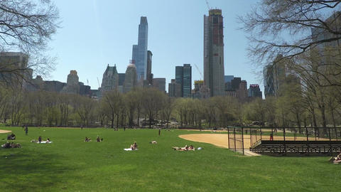 New York City, USA Central Park crowd relaxing on grass Footage