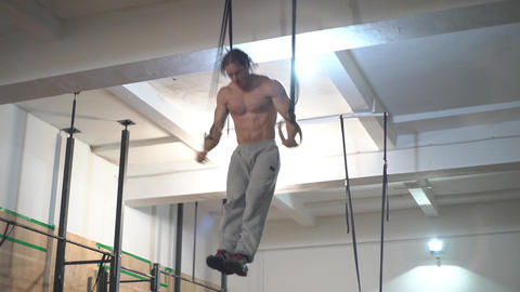 Male Man Athlete Working Out His Muscles On Rings, Crossfit Acrobat Training Footage