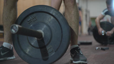 People Training In Crossfit Gym. Exercises With Barbell Footage