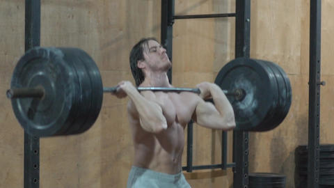 A Man Does Barbell Lifting Exercises Footage