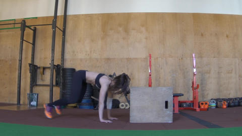 Girl Jumping Boxes In The Crossfit Gym Footage