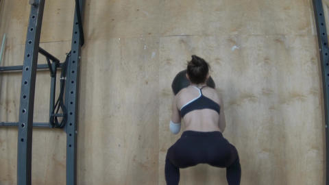 Young Strong Woman Exercising With Medicine Ball At Gym Footage