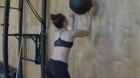 Girl Doing Crossfit Training. Female Athlete Squats During Workout Footage