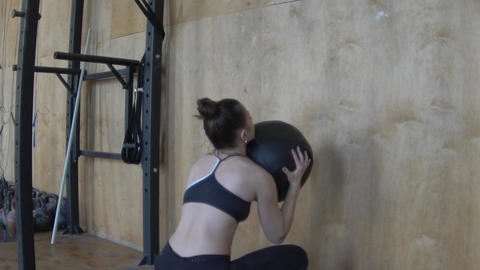 Young Strong Woman Exercising With Medicine Ball At Gym Slow Motion Footage