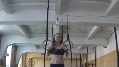 Slow Motion Girl Ring Muscle Ups Footage
