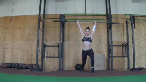 Of A Girl Lifting A Barbell With Heavy Weights Footage