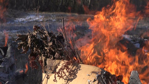Brown cardboard boxes with organic rubbish burning in the field Footage