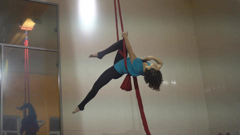 Pretty Woman - Aerialist Doing Acrobatic Tricks On Aerial Silks Footage