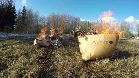 Boxes burning with organic rubbish, time lapse 4K Footage
