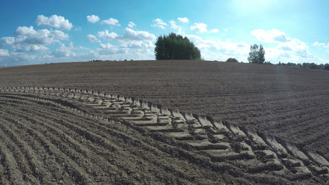 Tractor tracks on freshly plowed field, time lapse 4K Footage