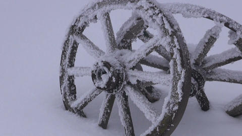 Landscape with two wooden wheels in snow covered by the forest Footage