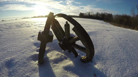Winter landscape with two wooden wheels and trees, time lapse 4K Footage