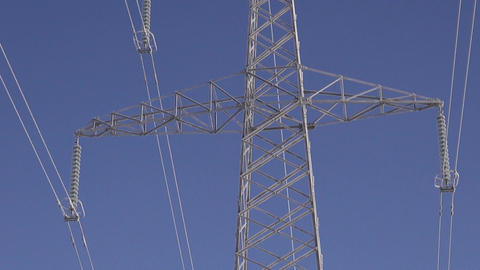 Landscape with electrical pylon in sunny winter's morning Footage