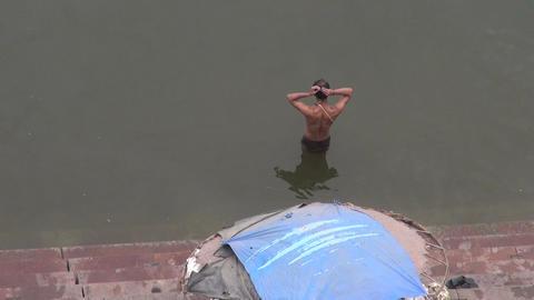 Spiritual ablutions of Brahman in Varanasi, sacred Ganges river, India Footage