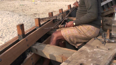 Craftsman making a boat with primitive tools in Varanasi Footage