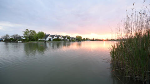 Time-lapse of sunset at Neusiedlersee (Lake Neusiedl) in Austria ビデオ