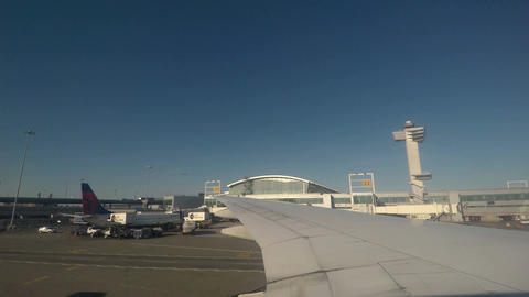 New York, USA JFK airport terminal and runway view Footage