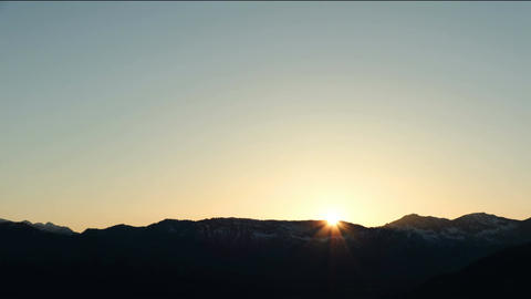 Sunset in the mountains with the plains time lapse Footage