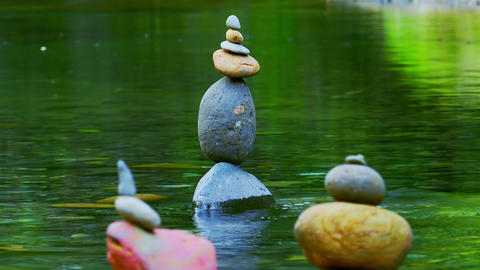 Meditation scene with stone piles in water. Balance, harmony and tranquility Footage