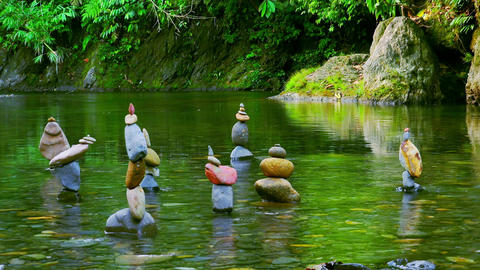 Group of pyramids made of stones in shallow pond. Calmness, meditation, zen Footage