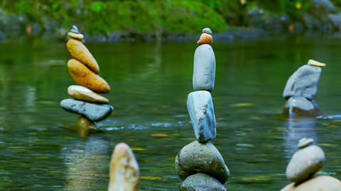 Meditation scene with stone piles in water. Balance, harmony and tranquility Live Action