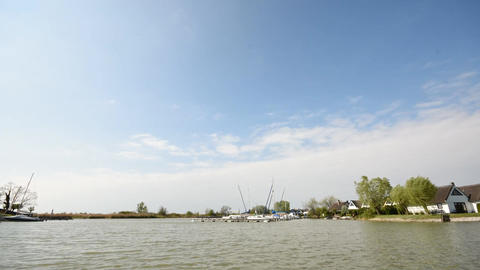 Time-lapse of boats passing by in a bay of the Neusiedlersee (Lake Neusiedl) ビデオ