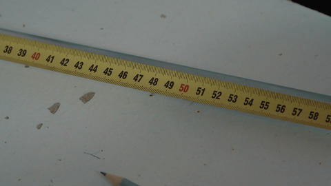 Worker measures length using a measuring tape Footage