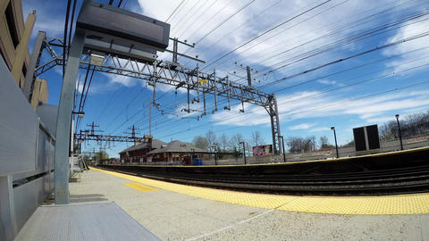 Time lapse with blue sky and clouds at the train station ビデオ