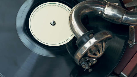 Tonearm needle of the old vintage gramophone slides along the track of the retro Footage