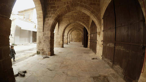 Outside Arched Vault of Buyuk Han child Enters In Frame Footage
