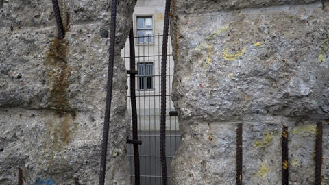 Handheld Looking Through Hole in Berlin Wall Footage