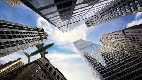 Skyscraper with Passing Airplane Image