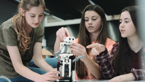 Girls working with small robot in classroom Footage