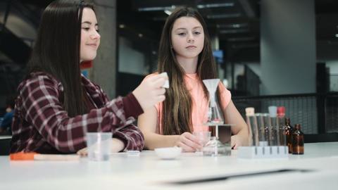 Girls practice chemistry at school Footage