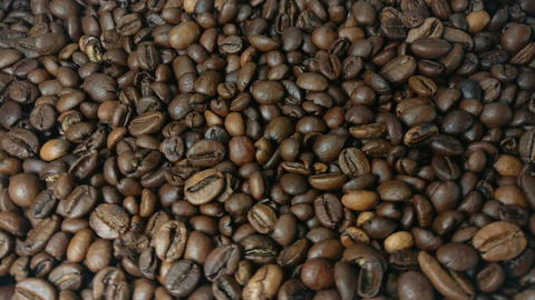 Falling and rotation roasted coffee beans in slow motion Footage