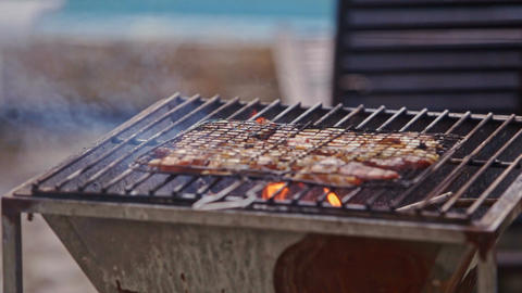 Meat Roasts on Fire on Barbecue Grid Guy Blows Footage