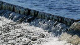 Water flows over weir Footage