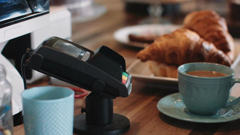Payment with contactless credit card in café Stock Video Footage