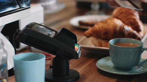 Payment with contactless credit card in café Footage