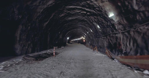 Steadycam shot inside a tunnel under construction Footage