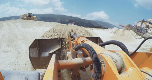 Point of view (POV) shot on a large loader working on a highway construction pro Footage