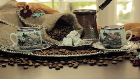 Turkish Coffee cup and saucer on a wooden table Footage