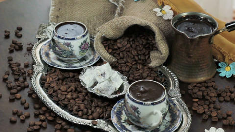 Turkish Coffee cup and saucer on a wooden table Filmmaterial
