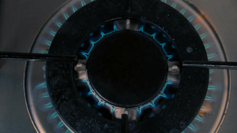 Gas burning from a kitchen gas stove - Dark closeup top view Footage