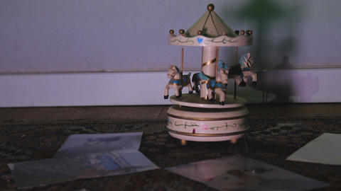 Old antique white children wooden carousel toy rotates on the floor Footage