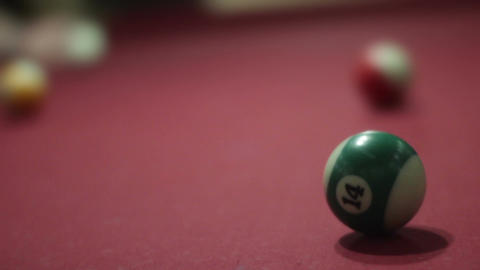 Green striped pool ball gets hit from other side of pool table Live Action