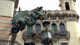 Spain Barcelona 032 dragon statue and city villa in La Rambla Footage