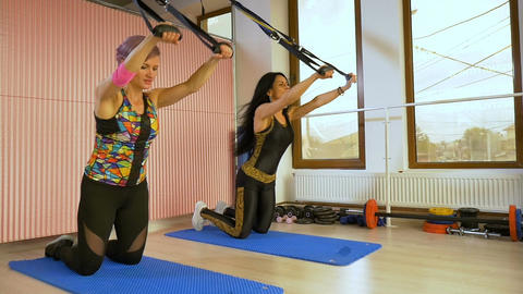 Workout and bodybuilding training concept of sportive women in the gym studio sl Live Action