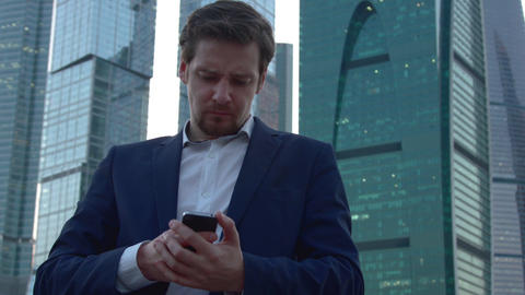 A man sits in social networks with mobile Footage