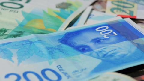 Stack of various of israeli shekel money bills - Tilt down Footage